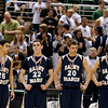 Record-Eagle/Jan-Michael Stump<br /> Traverse City St. Francis' Damon Sheehy (25), Riley O'Neil (22), Kyle White (20) and Ian Spencer (4) stand on the court after receiving their runner-up medals following Saturday's loss to Flint Beecher in the Class C state finals in East Lansing.