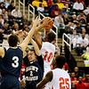 Record-Eagle/Jan-Michael Stump<br /> Traverse City St. Francis' Kody Kleinrichert (3) and Austin Curry (2) fight for a rebound with Flint Beecher's Monte Morris (10) in the first half of Saturday's Class C state finals in East Lansing.