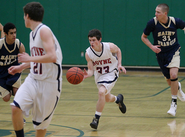 Record-Eagle/Keith King<br /> Boyne City's Keegan LaBlance dribbles the ball up the court against Traverse City St. Francis Monday, March 12, 2012 at Traverse City West High School.