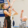 Record-Eagle/Brett A. Sommers Elk Rapids forward Jack Hawkins wins the opening tip over Glen Lake's Reece Hazelton Wednesday at Traverse City St. Francis. Glen Lake won the district semifinal 64-39.