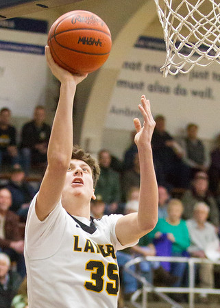 Record-Eagle/Brett A. Sommers Glen Lake forward Reece Hazelton glides to the basket for two points during Wednesday's boys basketball game against Elk Rapids at Traverse City St. Francis. Glen Lake won the district semifinal 64-39.