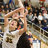 Record-Eagle/Brett A. Sommers Glen Lake forward Reece Hazelton (35) has the ball knocked away by Elk Rapids forward Jack Hawkins (2) during Wednesday's boys basketball game at Traverse City St. Francis. Glen Lake won the district semifinal 64-39.