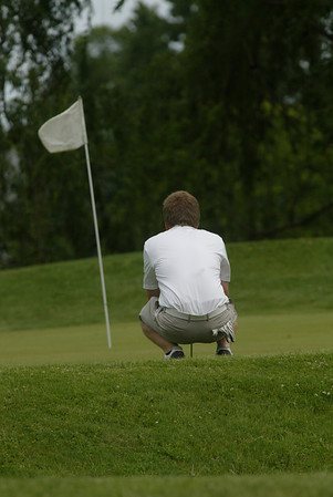 JUSTIN CRIPE | CORRESPONDENT<br /> Quinn Albin of Goshen lines up a putt on Hole #2 at Black Squirrel Golf Course during sectional play Saturday.