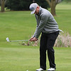 STEPHEN BROOKS | THE GOSHEN NEWS<br /> Wawasee golfer Jeffery Moore chips onto the green of the sixth hole at South Shore Golf Club on Saturday in the Wawasee golf invitational.