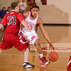 Record-Eagle/Jan-Michael Stump<br /> Suttons Bay's Dwuan Anderson (22) drives past Benzie Central's Michael Melton (33) in the second quarter of Tuesday's game.