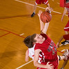 Record-Eagle/Jan-Michael Stump<br /> Benzie Central's Caleb Moss (44) grabs a rebound over  Suttons Bay's Jordan Anderson (20) in the first quarter of Tuesday's game.