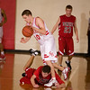 Record-Eagle/Jan-Michael Stump<br /> Benzie Central's Jacob Moilanen (10) tries to steal the ball from Suttons Bay's Jeff Lott (10) in the fourth quarter of Tuesday's game.