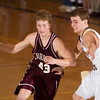 Record-Eagle/Jan-Michael Stump<br /> Charlevoix's Ben Myers (43) drives past Traverse City St. Francis' Luke Popp (11) in the first quarter Thursday night.