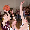 Record-Eagle/Jan-Michael Stump<br /> Charlevoix's Thomas Parrish (25) shoots over Traverse City St. Francis' Holden Greiner (3) in the first quarter Thursday night.