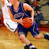 3-5-14  ---  Boys sectionals between Northwestern and Peru HS. Evan Matlock driving in.-- <br /> KT photo | Tim Bath