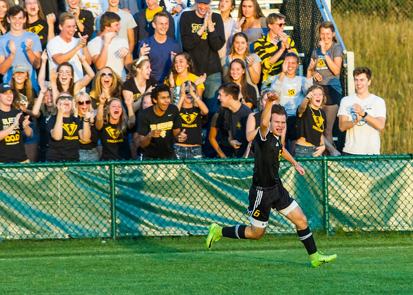 Record-Eagle/Brett A. Sommers Traverse City Central's William Kunz celebrate a first-half goal during Thursday's match against Traverse City West. The Trojans and Titans drew, 2-2.