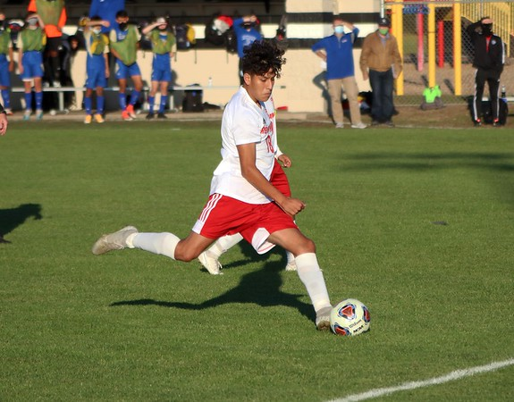 Goshen senior Fernando Quevedo shoots and scores on a free kick in the RedHawks' 4-1 loss to Elkhart Monday in the Class 3A, Sectional 4 boys soccer quarterfinals at Penn High School in Mishawaka.