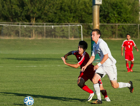 SAM HOUSEHOLDER | THE GOSHEN NEWS<br /> Goshen senior midfielder Kyle Ramirez Ingold, left and Northridge sophomore defender Tre Marvel chase after the ball during the game Tuesday.