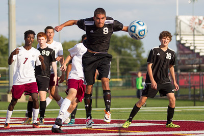 Cascade High School junior Ben Shepard (8) clears the corner kick with a header during the match between Cascade and Danville at Danville High School in Danville,IN. (Jeff Brown/Flyer Photo)