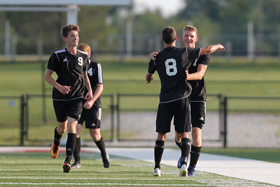 Cascade High School junior Ben Shepard (8) congratulates Cascade High School junior Zach Deurloo (7) on his goal during the match between Cascade and Danville at Danville High School in Danville,IN. (Jeff Brown/Flyer Photo)
