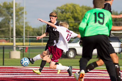 Danville High School freshman Hayden Klaum (12) shoots and scores the first goal of the match between Cascade and Danville at Danville High School in Danville,IN. (Jeff Brown/Flyer Photo)
