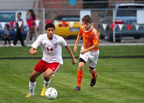 SAM HOUSEHOLDER | THE GOSHEN NEWS<br /> Goshen senior Alfredo Vasquez clears a ball against Warsaw Thursday at Goshen High School.