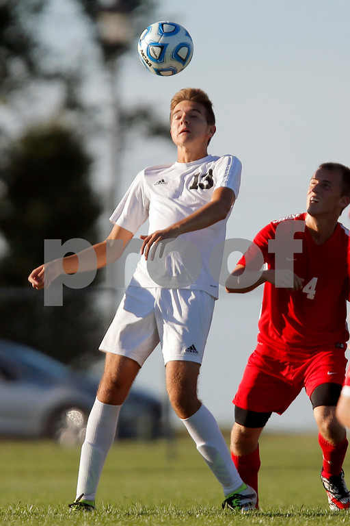 Cascade High School junior Kameron Byers (13) goes for the header during the match between Southmont vs Cascade Cascade High School in Clayton,IN. (Jeff Brown/Flyer Photo)