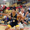 GREG KEIM | THE GOSHEN NEWS<br /> Junior Cordell Hofer of the Fairfield Falcons, No. 12, and senior Simon Myers of the Goshen RedHawks battle for position underneath the basket in a high school boys basketball game Saturday night at Goshen.