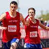 JAY YOUNG | THE GOSHEN NEWS<br /> West Noble's Brandon Pruitt (2204) reaches back to take the baton from teammate Kyle Mawhorter (2201) as they compete in the 4x200 relay during the 75th running of the Goshen Relays Saturday at Goshen High School.