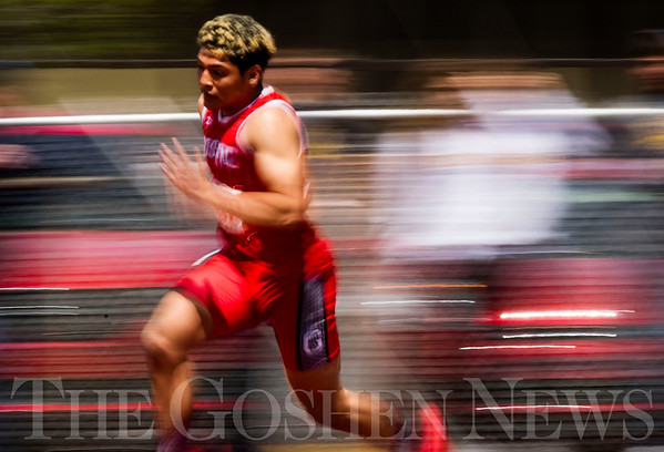 JAY YOUNG | THE GOSHEN NEWS<br /> Goshen's Rene Gutierrez speeds down the track while competing in the sprint medley relay during the 75th running of the Goshen Relays Saturday at Goshen High School.
