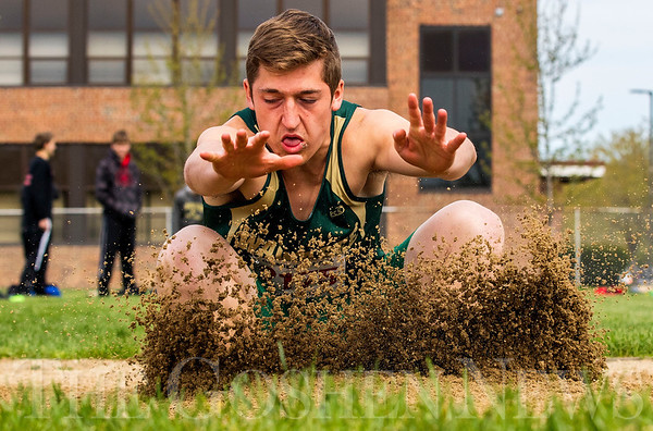 JAY YOUNG | THE GOSHEN NEWS<br /> Sand flies up as Wawasee's Michael Katzer lands while competing in the long jump during the 75th running of the Goshen Relays Saturday at Goshen High School.