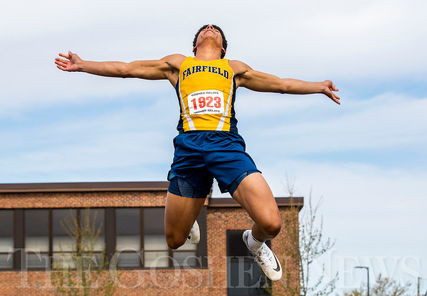 JAY YOUNG | THE GOSHEN NEWS<br /> Fairfield's Cordell Hofer soars through the air while competing in the long jump during the 75th running of the Goshen Relays Saturday at Goshen High School.