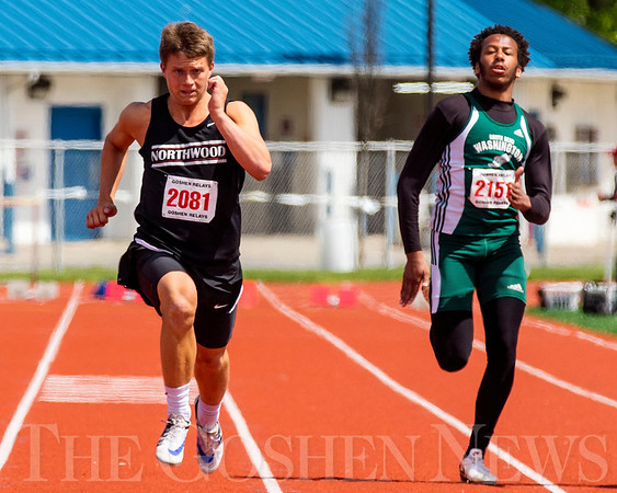 JAY YOUNG | THE GOSHEN NEWS<br /> NorthWood's Brayton Yoder (2081) and South Bend Washington's Jeremy Williams (2151) compete in the 100 meter dash final during the 75th running of the Goshen Relays Saturday at Goshen High School.
