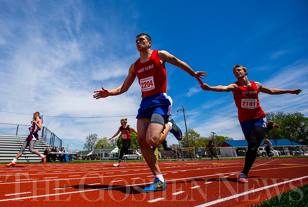 JAY YOUNG | THE GOSHEN NEWS<br /> West Noble's Brandon Pruitt (2204) receives the baton from Josh Gross (2191) as they compete in the 4x100 relay during the 75th running of the Goshen Relays Saturday at Goshen High School.