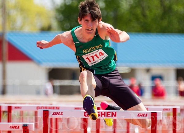JAY YOUNG | THE GOSHEN NEWS<br /> Northridge's Nathan Weaver clears a hurdle while competing in the finals of the 110 meter high hurdles during the 75th running of the Goshen Relays Saturday at Goshen High School.