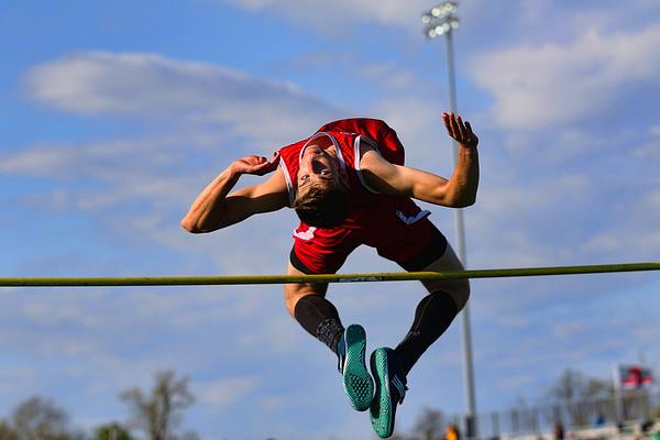 JAY YOUNG | THE GOSHEN NEWS<br /> Goshen High's Simon Myers arches his back as he clears the bar while competing in the high jump event at the 47th annual Kelly Relays Friday evening at Concord High School.