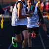 JAY YOUNG | THE GOSHEN NEWS<br /> Concord High's Alec Eash, front, takes off after receiving the baton from Shakim Riley as they race in the 4x400 relay at the 47th annual Kelly Relays Friday evening at Concord High School.