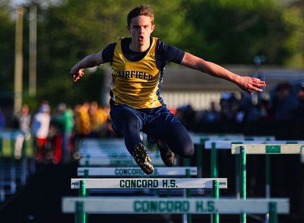 JAY YOUNG | THE GOSHEN NEWS<br /> Fairfield's Nathan Weaver leaps over a low hurdle as he competes in the hurdle relay at the 47th annual Kelly Relays Friday evening at Concord High School.