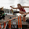 JAY YOUNG | THE GOSHEN NEWS<br /> Goshen High's Jillian Kissinger clears a hurdle as she competes in the finals of the 100 meter hurdles during the Norther Lakes Conference Championship track meet Tuesday evening in Warsaw.