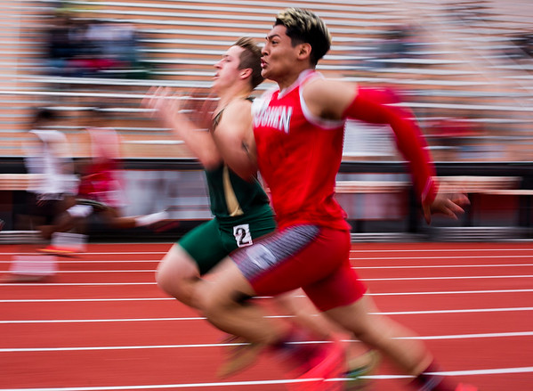 JAY YOUNG | THE GOSHEN NEWS<br /> Goshen High's Rene Gutierrez runs side-by-side with Wawasee's Michael Katzer as they try to earn a place in the 100 meter dash finals during the Norther Lakes Conference Championship track meet Tuesday evening in Warsaw.