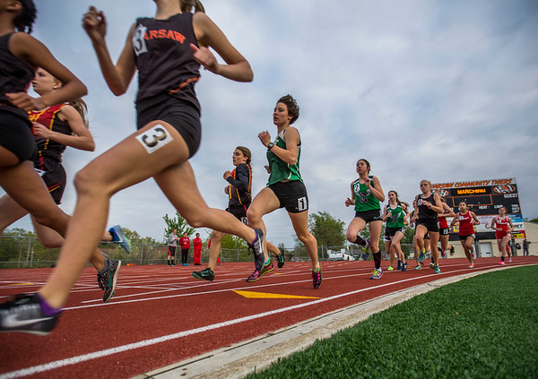 JAY YOUNG | THE GOSHEN NEWS<br /> Wawasee's Elizabeth Zorn (1) runs in a pack as she competes in the 1600 meter run during the Norther Lakes Conference Championship track meet Tuesday evening in Warsaw.