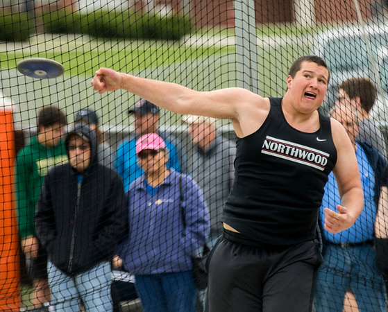 JAY YOUNG | THE GOSHEN NEWS<br /> NorthWood's Caleb Newcomer lets out a yell as he releases the discus during the Norther Lakes Conference Championship track meet Tuesday evening in Warsaw.