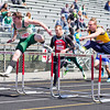 SAM HOUSEHOLDER | THE GOSHEN NEWS<br /> Wawasee runner Clayton Cook, left, leads Fairfield runner Cameron Kitson, right and Prairie Heights' Zach Shepard during the Class B high hurdles finals at the 72nd running of the Goshen Relays Saturday.