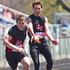 SAM HOUSEHOLDER | THE GOSHEN NEWS<br /> NorthWood runners Travis Bear, front and Garrett Griffin hand off the baton during a relay event at the Goshen Relays Saturday.