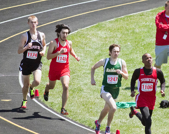 SAM HOUSEHOLDER | THE GOSHEN NEWS<br /> From right, Fort Wayne North Side runner Valentin Emmanuel leads Northridge's Blake O'Dell, Goshen's Gerardo Abad and Laporte's Sam Miller.