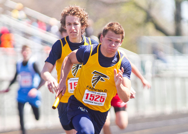 SAM HOUSEHOLDER | THE GOSHEN NEWS<br /> Fairfield's Mitch DeWitt (1525) takes off after receiving the baton from teammate Konrad Dallas during a Class B relay race at the Goshen Relays Saturday. Around 40 teams participated in the 72nd running of the event.