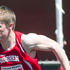 SAM HOUSEHOLDER | THE GOSHEN NEWS<br /> Goshen runner Joey Rockwood takes off during a relay race Saturday during the 72nd running of the Goshen Relays.