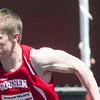 SAM HOUSEHOLDER | THE GOSHEN NEWS<br /> Goshen runner Joey Rockwood takes off during a relay race Saturday during the 72nd running of the Goshen Relays.