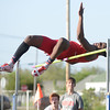 HALEY WARD | THE GOSHEN NEWS<br /> Goshen junior Rummel Johnson leaps over the bar in the high jump Thursday during the Goshen Sectionals. Johnson finished first in the event.