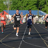 HALEY WARD | THE GOSHEN NEWS<br /> Runners cross the finish line during the Boys 100 Meter Dash Finals on Thursday during the Goshen Sectionals.
