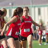 SAM HOUSEHOLDER | THE GOSHEN NEWS<br /> Goshen junior Adrienne Henke (713), hands off the baton to Goshen freshman Ashton Ellis Tuesday during the 3200 meter relay at the Girls Sectional Track Meet at Warsaw High School.