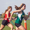 SAM HOUSEHOLDER | THE GOSHEN NEWS<br /> Northridge freshman Brey Baltazar, right and Goshen junior Adrienne Henke run the 3200 meter relay Tuesday during the sectional track meet at Warsaw High School.