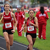 GREG KEIM | THE GOSHEN NEWS<br /> Hannah Kurtz, No. 887 of the Goshen RedHawks tries to catch No. 957 Amani Miles of North Central in the Class A 4 x 400-meter relay Saturday at the Goshen Girls Relays.