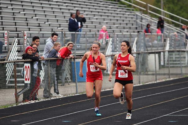 GREG KEIM | THE GOSHEN NEWS<br /> Jenny Bustos, No. 861 of the Goshen RedHawks races Kacee Peters of Plymouth on the anchor leg of the Class A 4 x 100 relay Saturday at the Goshen Girls Relays.