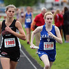GREG KEIM | THE GOSHEN NEWS<br /> Erica Stutsman, No. 1369 of the NorthWood Panthers battles No., 1319 Mary Rice of Mishawaka Marian on he anchor leg of the Class B distance medley relay Saturday at the Goshen Girls Relays.
